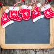 Christmas tree decorations border on vintage wooden blackboard — Stock Photo #33627343
