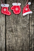 Red Christmas tree decorations on grunge wood — Stock Photo
