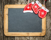 Christmas tree decorations on vintage wooden blackboard — Stock Photo
