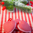 Christmas tree decorations and branch on red gingham tablecloth — Stok fotoğraf