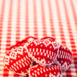 Christmas tree decorations on red gingham tablecloth — Stok fotoğraf
