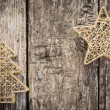Gold Christmas tree decorations on grunge wood — Stock Photo