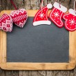 Christmas tree decorations on vintage wooden blackboard — Stock Photo