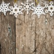 Snowflakes border on wood — Stockfoto