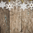 Snowflakes border on wood — 图库照片