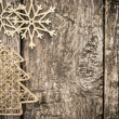 Gold Christmas tree decorations on grunge wood — Stock Photo #34648447