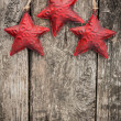 Redd Christmas tree decorations on grunge wood — Stock Photo #34648459