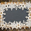 Blackboard blank framed in wooden snowflakes — Stock Photo