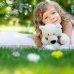 Child lying on grass — Stock Photo