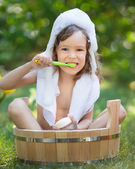 Child bathing outdoors in spring — Foto Stock