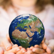 Family holding Earth planet — Stock Photo