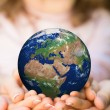 Family holding Earth planet — Stock Photo #40940907