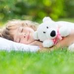 Child sleeping in spring garden — Stock Photo