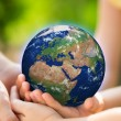 Children holding Earth in hands — Stock Photo #40941205