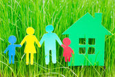 Paper family and house in grass — Stock Photo