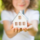 Child holding house — Stock Photo
