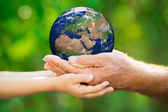 Child and man holding Earth in hands — Stock Photo