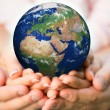 Family holding Earth planet — Stock Photo #41752217