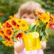 Child with bouquet of flowers — Stock Photo