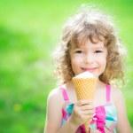 Happy child eating ice cream — Stock Photo #41752305