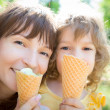 Happy child and mother eating ice cream — Stock Photo