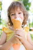 Happy child eating ice cream — Stock Photo