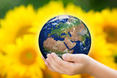 Child holding Earth in hands — Stock Photo