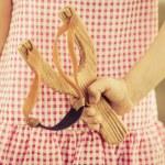 Kid holding slingshot — Stock Photo #42217519