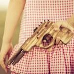 Girl holding wooden gun — Stock Photo #42609187