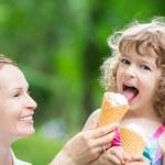 Happy child eating ice cream — Stock Photo #42609383