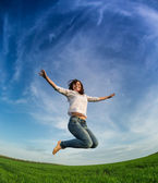 Happy woman jumping — Stockfoto