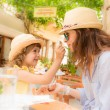 Hipster woman and girl in summer cafe — Stock Photo #43568679