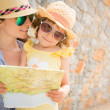 Hipster woman and girl in summer city — Stock Photo #43932889