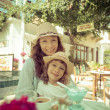 Mother with child in summer cafe — Stock Photo #44472927