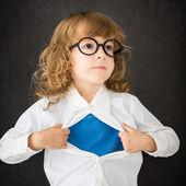 Superhero child in class — Stock fotografie