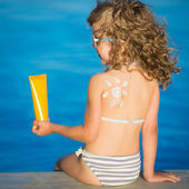 Sunscreen lotion drawing sun — Stock Photo