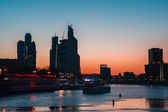 Sunset Navigation on Moscow river in wintertime. Leisure boat and Moscow skyline — Stock Photo