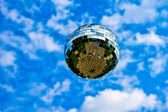 Dream Flight. A glass reflection sphere in the air against the blue sky and white clouds — Stock Photo