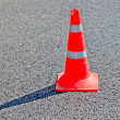 Red guarding road cone on asphalt — Foto de Stock
