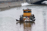 Garbage collector vessel going along the river — Stock Photo
