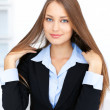 Cute young business woman with beautiful long straight hair — Stock Photo #13880225
