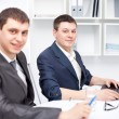 Two young businessmen working together in office — Stock Photo #13881308