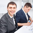 Two young businessmen working together in office — Stock Photo #13881320