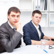 Two young businessmen working together in office — Stock Photo #13881349