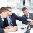 Stock Photo: Team of young business men working together at office