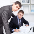 Two young businessmen working together in office — Stock Photo