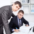 Two young businessmen working together in office — Stock Photo #13881392