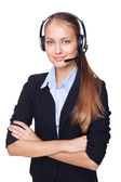 Portrait of young female call centre employee with a headset on — Stock Photo