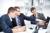 Team of young business men working together at office — Stock Photo