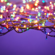 Christmas lights on dark blue background with copy space. Decora — Stock Photo #14075170